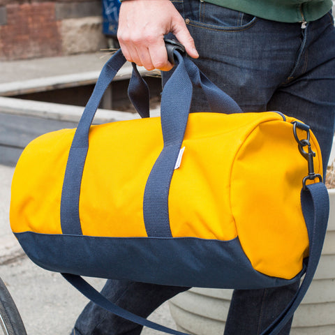 "Gold and Navy ""Stay Sharp"" Duffel"
