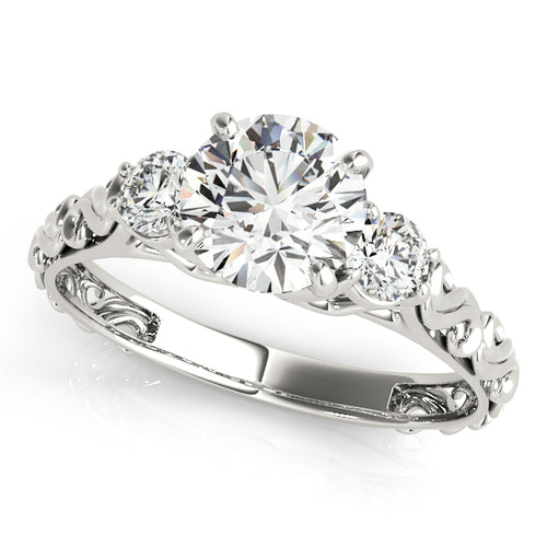Round Cut Three-Stone Engagement Ring with Filigree Accents