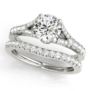 Round Cut Cathedral Style Engagement Ring with Graduated Accents