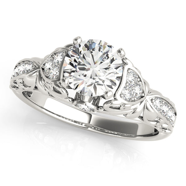 Cathedral Style Round Cut Engagement Ring with Intricate Accents