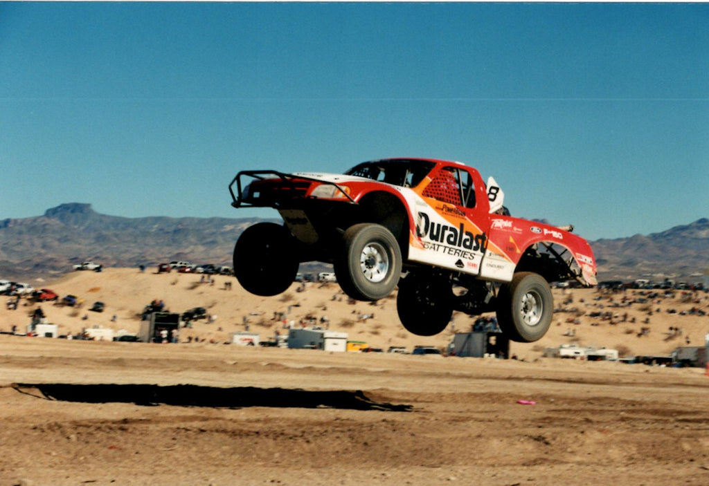 Dave Ashley Duralast Trophy Truck jumping in and off road race