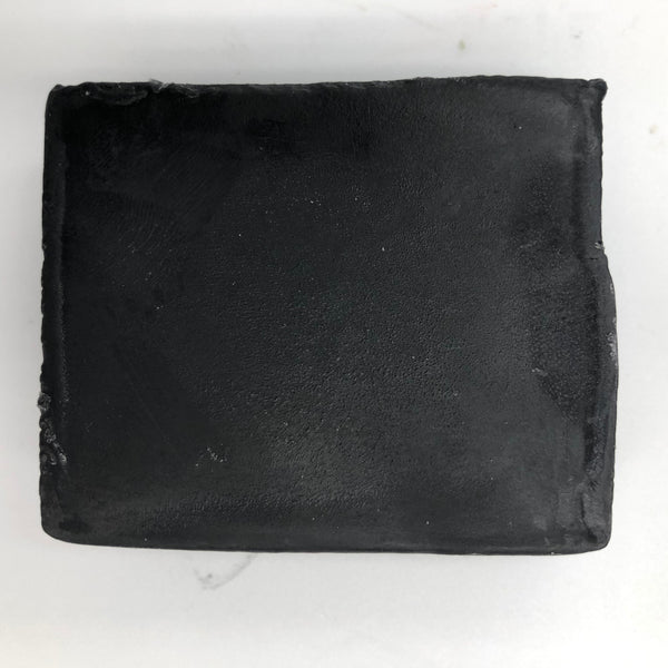 Side view of Fancy Black, a handmade, organic soap bar