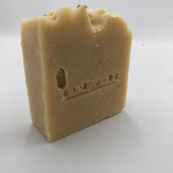 Side view of Holy Oaty, a handmade, organic soap bar