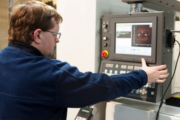 Man working with automated equipment