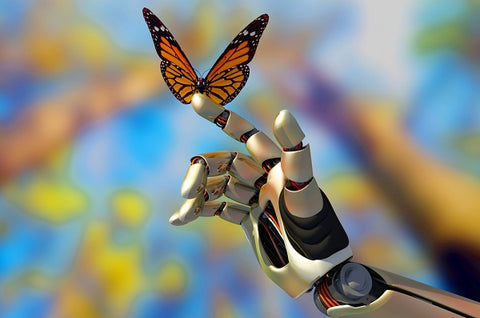 Robotic hand with a butterfly on it.
