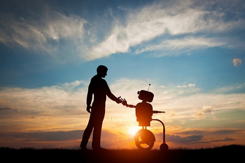 Photo of man and robot meet and handshake