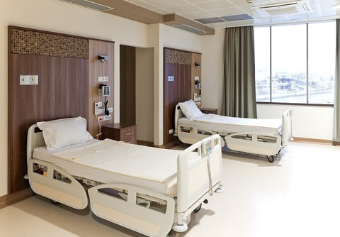 Photo of a hospital room with two empty beds