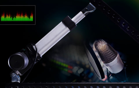 Photo of concept noiseless a linear actuator on black background and microphone