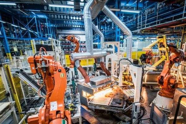 Robot arms in factory's production line