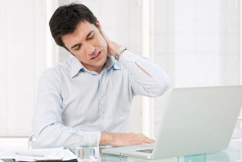 Photo of a man sitting for a laptop