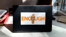 "Load image into Gallery viewer, ""ENOUGH"" tiny trump laptop sticker shown with a ""Racist"" tiny trump stuck on top"