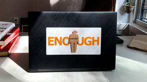 """ENOUGH"" tiny trump laptop sticker shown with a ""Racist"" tiny trump stuck on top"