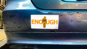 """ENOUGH"" tiny trump bumper sticker shown with a ""Fake News"" tiny trump stuck on top"