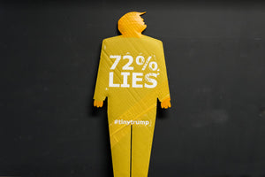 "A two foot tall, cardboard tiny trump with the slogan ""72% Lies"""