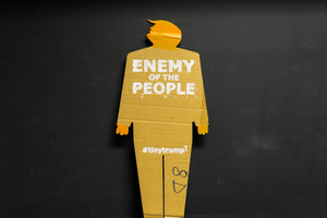 "A two foot tall, cardboard tiny trump with the slogan ""Enemy of the People"""