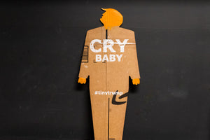 "A two foot tall, cardboard tiny trump with the slogan ""Cry Baby"""