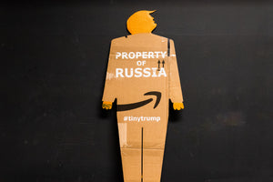 "A two foot tall, cardboard tiny trump with the slogan ""Property of Russia"""