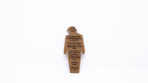 "The back of a tiny trump showing a peel off label with the following text: ""tiny trump is guaranteed to minimize trump in your life! Put him somewhere, take a pic, and tag #tinytrump on social media. Then peel this off and stick him somewhere to minimize trump in other people's lives. It really works! Get more at maketrumptiny.com"""