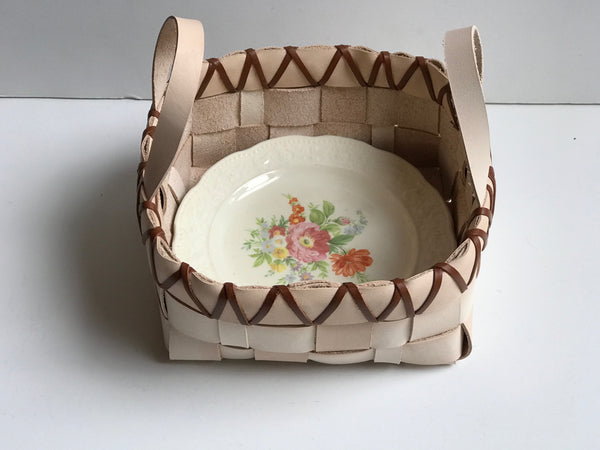TABLETOP BASKET WITH HANDLES AND VINTAGE FLORAL CHINA PLATE