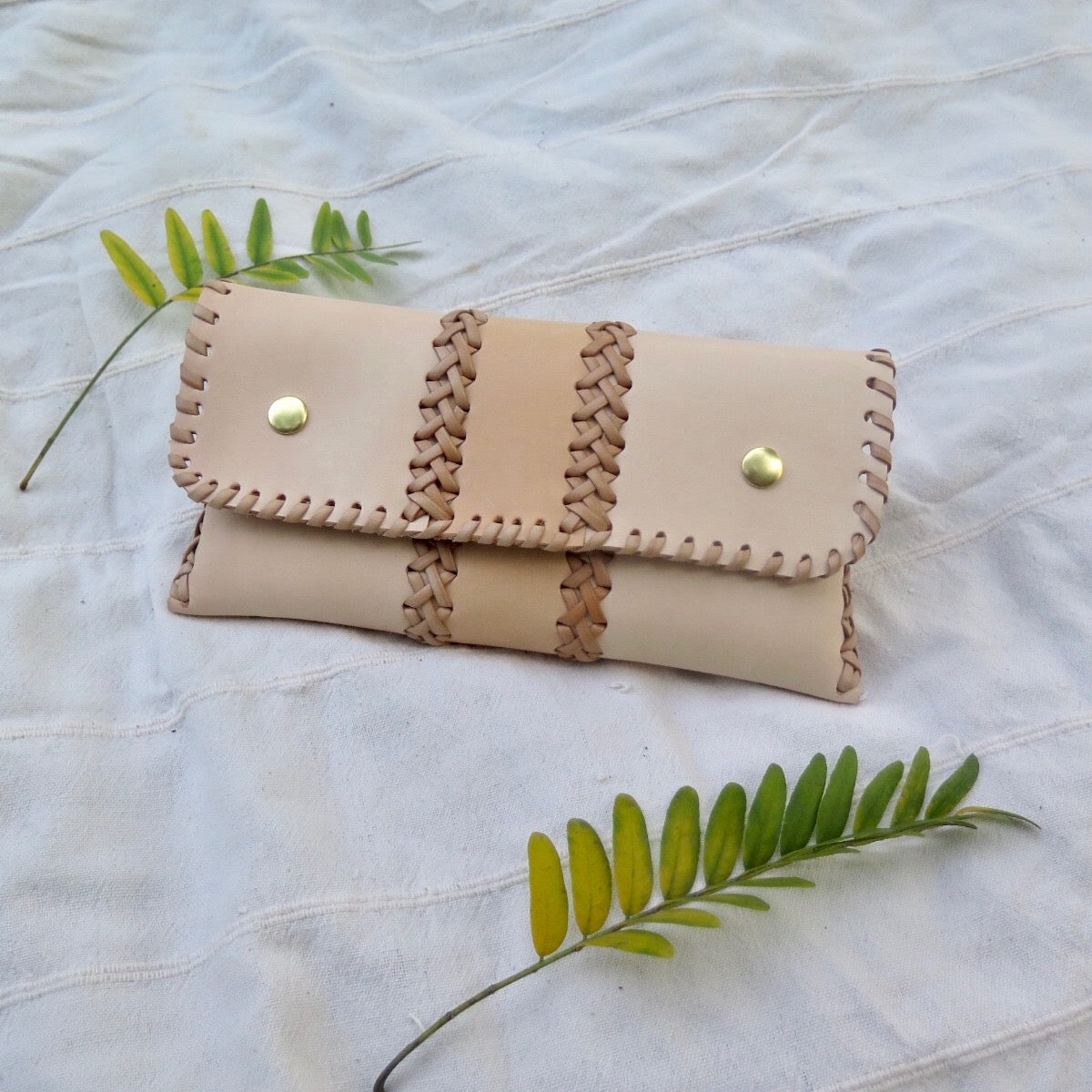 SMALL LEATHER BRAIDED CLUTCH