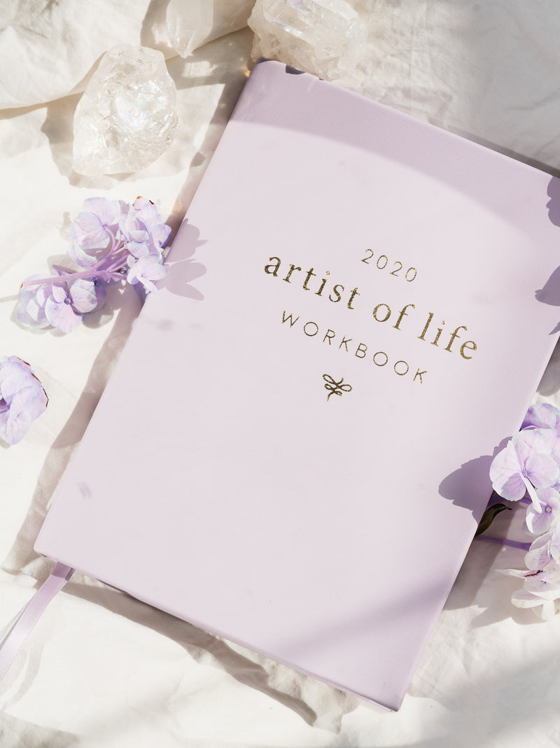 lavender artist of life workbook surrounded by white crystals and purple flowers