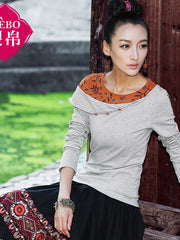 sloping embroidered shoulder top