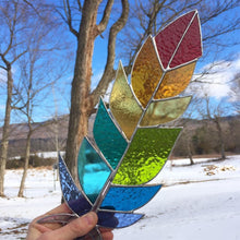 nature inspired stained glass home decor handmade in vermont by artist carrie root of the root studio. this piece is a beautiful giant rainbow feather