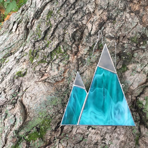Stained glass green mountains with snowy tops. Unique home decor inspirational gifts for the nature lover. Handmade in Vermont by artist Carrie Root of the Root Studio