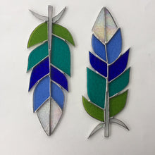 Giant green/blue stained glass feather handmade in Vermont by artist Carrie Root of the Root Studio. Unique nature inspired stained glass gifts and home decor.