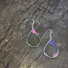 stained glass earrings are made with a magical piece of clear but textured iridescent glass. Handmade in Vermont by artist Carrie Root, these unique glass earrings hang on sterling silver ear wires and catch the light beautifully at every angle.