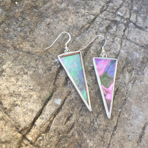 stained glass triangle earrings are made with a magical piece of clear but textured iridescent glass. Handmade in Vermont by artist Carrie Root, these unique glass earrings hang on sterling silver ear wires and catch the light beautifully at every angle.