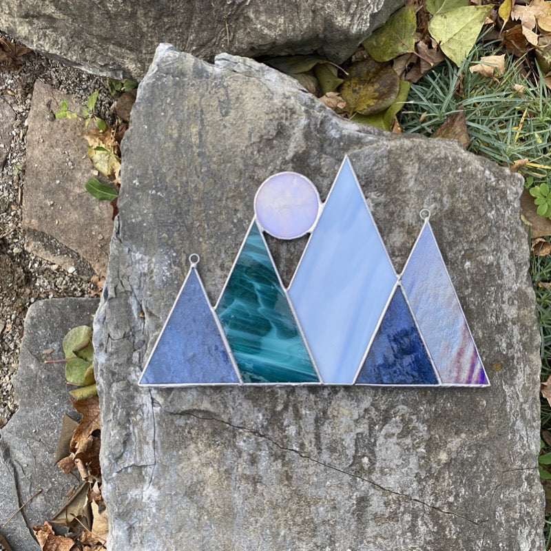 Mountainscape stained glass home decor art with a full moon accent. Handmade in vermont by artist carrie root of the root studio.