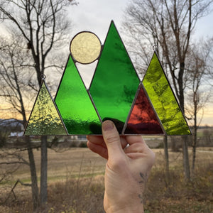 mountains and sun or moon stained glass home decor.  handmade in vermont by artist carrie root of the root studio.  green mountain art inspired by vermont