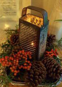 Love this, vintage cheese grater over a candle.