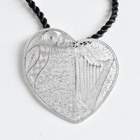 Lace-filigree heart harp pendant