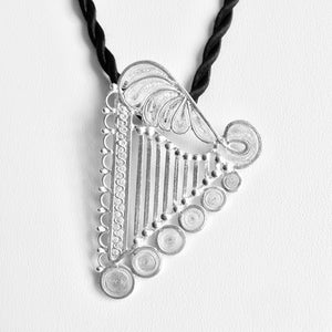 "The handmade Luzma Sterling Silver filigree harp pendant is 2 7/16"" tall (6.2 cm). You may wear it with your favorite chain, cord, or a color silk ribbon to match or contrast you clothing. Observe the exquisite and intricate filigree details.  Match with filigree earrings."