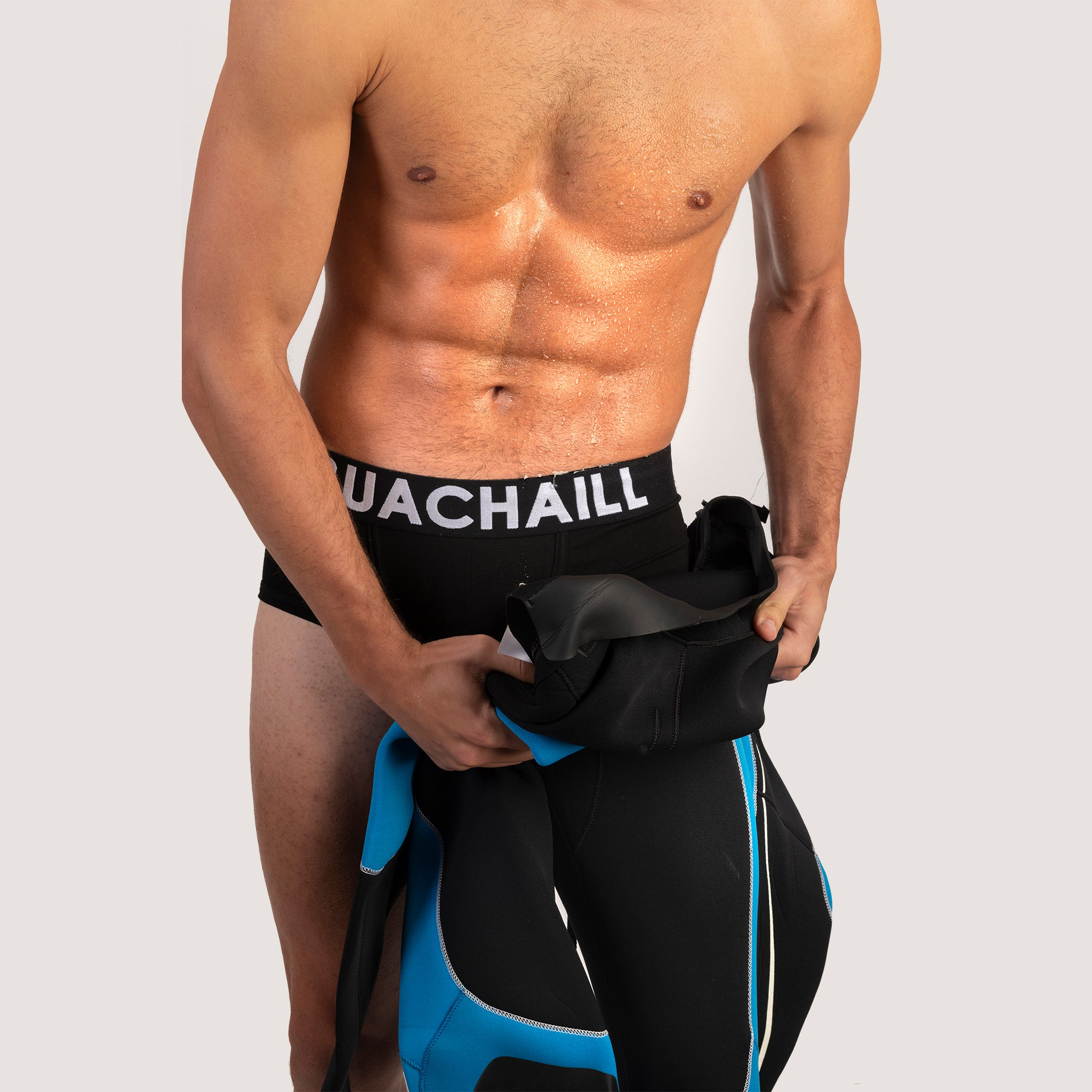 Black Buachaill boxer shorts and a diving suit