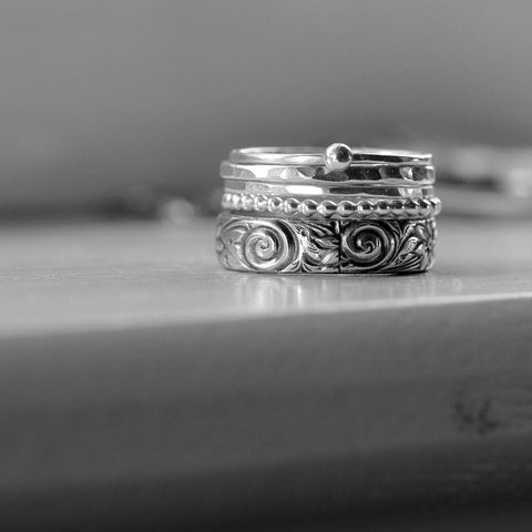 Five Sterling Silver Rings in a Stack