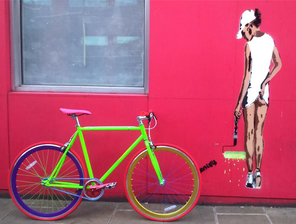 It is Untitled. A 56cm frame in bright green, gold and blue rims and pink saddle. Untitled is all about you.