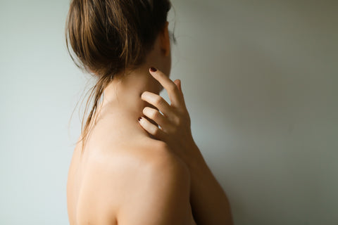 moisturized woman shoulder facing sideways