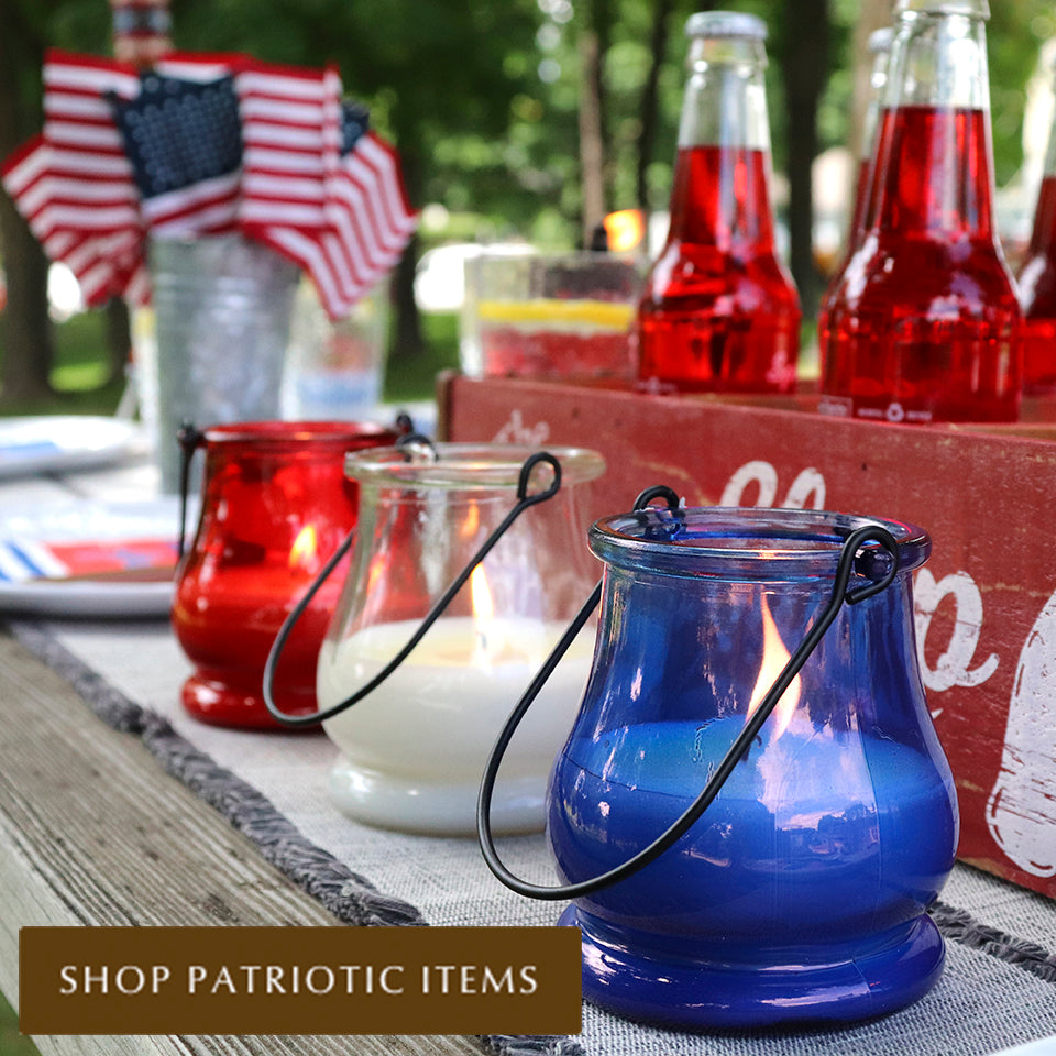 Red, White and Blue Citronella Candles at a 4th of July Party