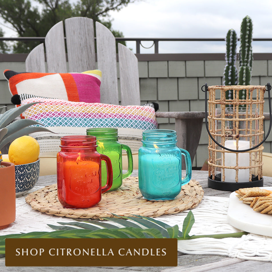 Bright Mason Jar Citronella Candles on patio table