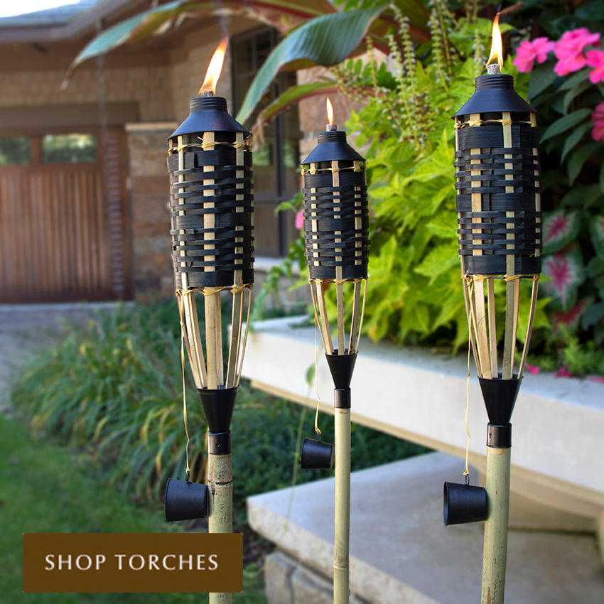 Black and tan woven bamboo tiki torches by Patio Essentials