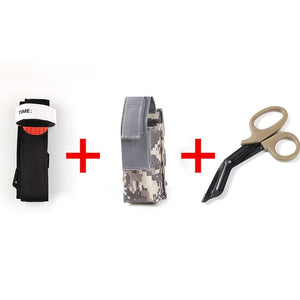 survival tourniquet with pair of black scissors on white background