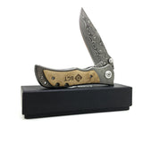 folding tactical knife for outdoor survival on his box and on white background