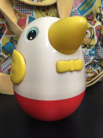 Vintage weeble-wobble musical chick