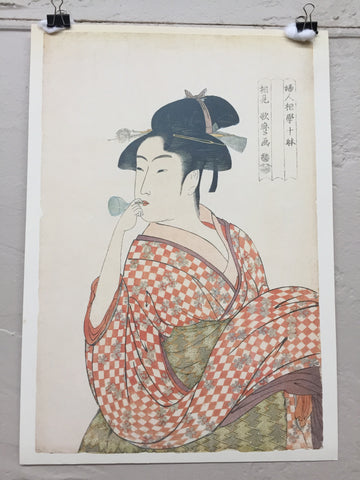 Girl Blowing a Glass Pipe print by Kitagawa Utamaro