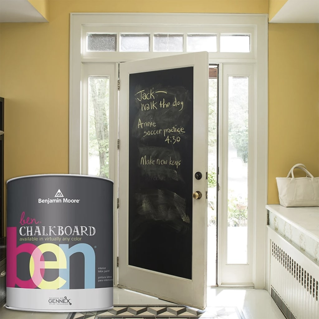 Interior side of an enteryway door paint in black Benjamin Moore Chalkboard paint.