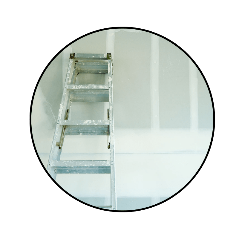 silver ladder leaning against a newly drywalled wall, ready for primer before paint