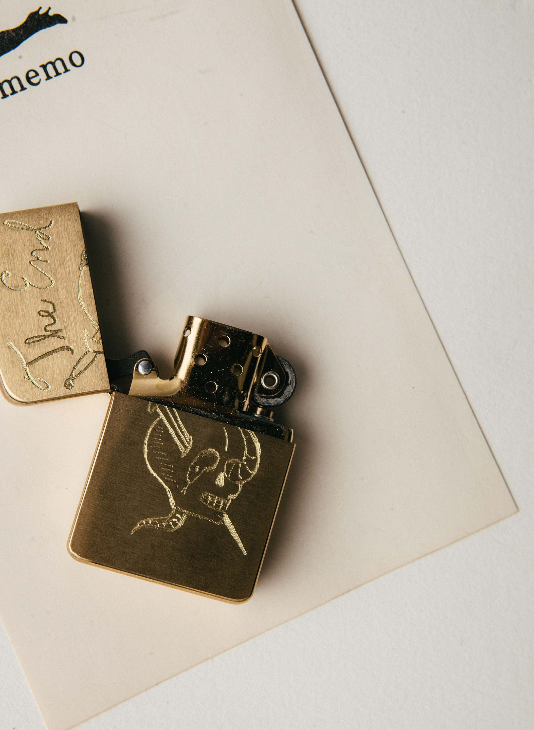 "imogene + willie - engraved ""the end"" brass zippo"